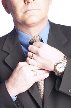 Man Tying a Tie